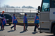 The last 33 of 1,200 prisoners board a bus at Deerfield Correctional Facility before transporting out of the closing prison in Ionia, MI, Friday, March 20, 2009. All employees have been absorbed into the four other prisons in the town. The prisoners were heading to West Shoreline Correctional Facility in Muskegon, MI.
