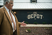 AUBURN, AL – NOVEMBER 20, 2016: Philip Dunlap stands in front of The Depot, a historic train depot recently renovated into an upscale restaurant. Dunlap, the city of Auburn's Economic Development Director, worked for the city of Birmingham for nearly a decade until he was recruited by the city of Auburn in 1984 to start the city's Economic Development Program. Since that time, the city has witnessed significant growth and development.<br /> <br /> In much of the United States, global trade and technological innovation has failed to produce the prosperity hoped for by political and business leaders. Yet despite formidable economic challenges, some localities are flourishing. In Lee County, Ala., unemployment is below the national average despite the loss of thousands of manufacturing jobs, and the key to the county's resilience may be Auburn University, which provided a steady source of employment during recessions and helped draw new businesses to replace those that fled. CREDIT: Bob Miller for The Wall Street Journal<br /> [RESILIENT]