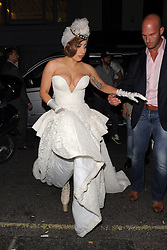 Lady Gaga wearing a gold crown and white dress enjoys a night out at The Arts Club in Mayfair, London, UK. 09/09/2012<br />BYLINE MUST READ : GOTCHAIMAGES.COM<br /><br />Copyright by © Gotcha Images Ltd. All rights reserved.<br />Usage of this image is conditional upon the acceptance <br />of Gotcha Images Ltd, terms and conditions available at<br />www.gotchaimages.com