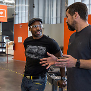 BALTIMORE, MD - FEB23: Chris Wilson, 38, a business owner in Baltimore, talks to his business advisor and mentor Jason Hardeback at The Foundery, a maker space in Baltimore, MD. Wilson went to prison at age 17 for murder, but got his associates degree while in prison and was able to attend the University of Baltimore after his release. He testified in Annapolis about the ban the box movement in Maryland which would remove the question about a person's criminal history from college applications.(Photo by Evelyn Hockstein/For The Washington Post)