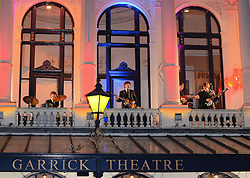 The cast of 'Let It Be' perform to the public from the balcony of the Garrick Theatre before the Press Night show at The Garrick Theatre, Charing Cross Road, London on Wednesday 11 March 2015