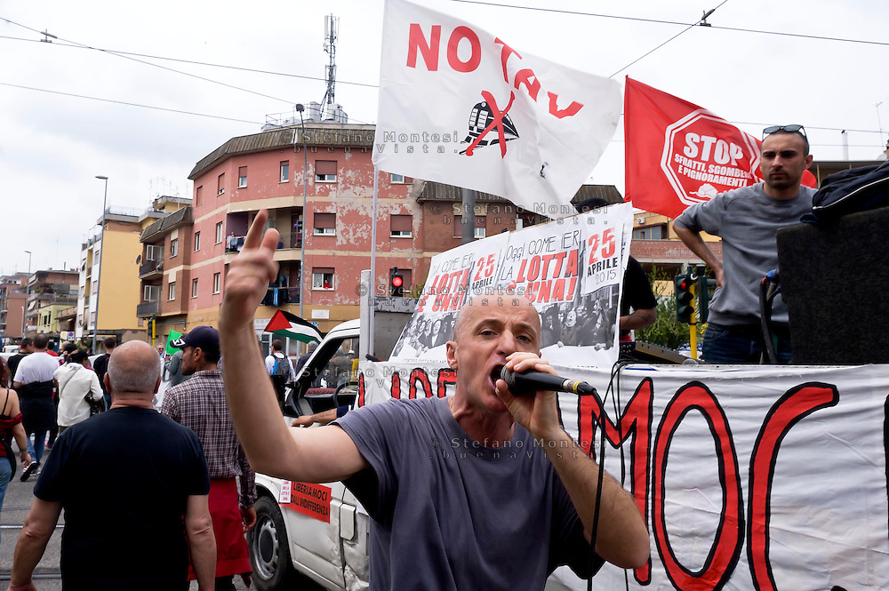 Roma, 25 Aprile 2015<br /> Manifestazione meticcia, antifascista, e contro il razzismo al quartiere  Tor Sapienza per il  giorno del  70esimo anniversario della Liberazione dal nazi-fascismo. Nella foto:  Militant A di Assalti Frontali.<br /> Rome, April 25, 2015<br /> Demostration antifascist, and  against racism to the neighborhood Tor Sapienza for the day of the 70th anniversary of the liberation from Nazi-Fascism.
