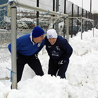 St Johnstone players Kim Weir and Nathan Lowndes duck out of the way of snowballs during training this morning.<br />see story by Gordon Bannerman Tel: 01738 493213<br /><br />Pic by Graeme Hart<br />Copyright Perthshire Picture Agency<br />Tel: 01738 623350 / 07990 594431