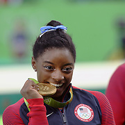 Gymnastics - Olympics: Day 6  Simone Biles #391 of the United States with her gold medal in the Artistic Gymnastics Women's Individual All-Around Final at the Rio Olympic Arena on August 11, 2016 in Rio de Janeiro, Brazil. (Photo by Tim Clayton/Corbis via Getty Images)