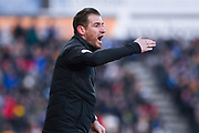 Jan Siewert of Huddersfield Town (Manager) urges his team forward during the Premier League match between Huddersfield Town and Arsenal at the John Smiths Stadium, Huddersfield, England on 9 February 2019.