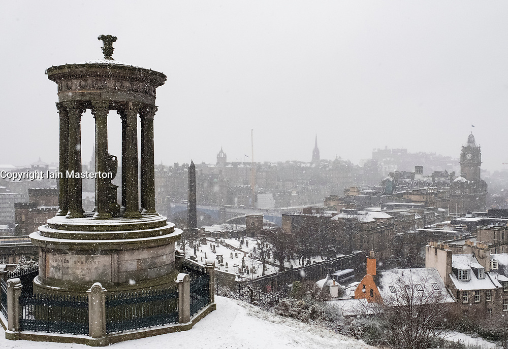 Edinburgh, Scotland, United Kingdom. 29 December, 2017; Snow falls on Edinburgh enhancing views of the city. View from Calton Hill of the city.
