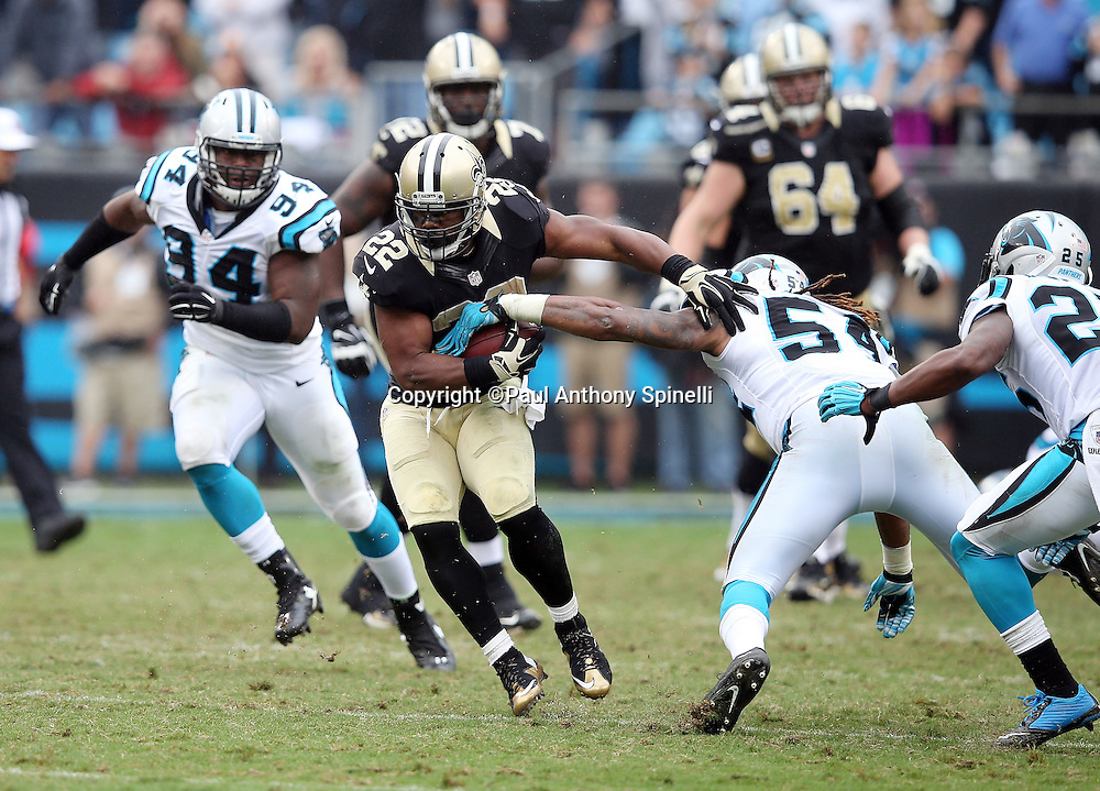 New Orleans Saints running back Mark Ingram (22) catches a fourth quarter pass for a first down as he gets chased down by Carolina Panthers outside linebacker Shaq Green-Thompson (54) and Carolina Panthers cornerback Bene' Benwikere (25) during the 2015 NFL week 3 regular season football game against the Carolina Panthers on Sunday, Sept. 27, 2015 in Charlotte, N.C. The Panthers won the game 27-22. (©Paul Anthony Spinelli)