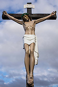 A statue of Jesus Christ on the crucifix outside a Church on Wilson Street in Middlesborough, England, UK.