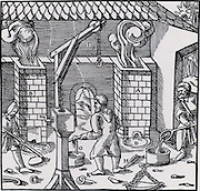 Crane for lifting of copper/lead alloy from moulds. From 'De re metallica', by Agricola, pseudonym of Georg Bauer (Basle, 1556).  Woodcut.