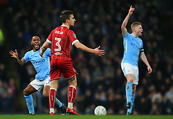 Raheem Sterling of Manchester City reacts towards Joe Bryan of Bristol City - Mandatory by-line: Matt McNulty/JMP - 09/01/2018 - FOOTBALL - Etihad Stadium - Manchester, England - Manchester City v Bristol City - Carabao Cup Semi-Final First Leg
