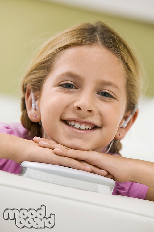 Girl Listening to Portable CD Player