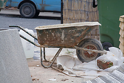 Cement wheelbarrow during building work,