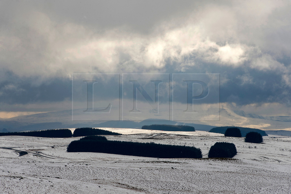 © Licensed to London News Pictures. 04/04/2019. Builth Wells, Powys, Wales, UK. Wild wintry landscapes are seen on the Mynydd Epynt range between Builth Wells and Brecon in Powys, UK. Photo credit: Graham M. Lawrence/LNP