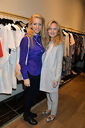 Left to right, OLGA KABYSH and IRINA YASTRIB at the Salt Store VIP Shopping event at 77 Eliabeth Street, London on 2nd December 2015.