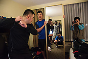 Practicing in their hotel room after hours, Daohuei Yang, 34, left, stands in as the batter, Chiu Hiko, 29, catches, and Evan Yu, 36, holds the mirror, so Jarvis Wu, 32, can check his mechanics as he makes strike, ball and out calls. All four are umpires in the Chinese Professional Baseball League and came to the five week Wendelstedt Umpire School in Daytona Beach, Fla. together. Sophiya Liu, 36, far right, takes pictures to document the moment. Liu is the first female umpire in the CPBL and was a student at the school last year. She came back to translate for the umpires from Taiwan.