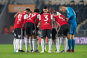 Brentford players huddle prior to the start of the second half during the EFL Sky Bet Championship match between Hull City and Brentford at the KCOM Stadium, Kingston upon Hull, England on 15 December 2018.