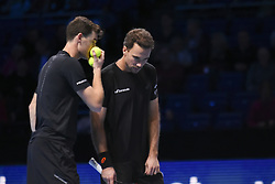 November 17, 2017 - London, England, United Kingdom - Britain's Jamie Murray (L) speaks with his partner Brazil's Bruno Soares (R) during their men's doubles round-robin match against Brazil's Marcelo Melo and Poland's Lukasz Kubot on day six of the ATP World Tour Finals tennis tournament at the O2 Arena in London on November 17, 2017. (Credit Image: © Alberto Pezzali/NurPhoto via ZUMA Press)