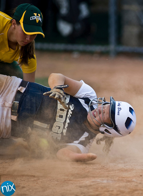 Hickory Ridge's Ally Yeager is tagged out at home plate by Central Cabarrus' Erica Bost Tuesday evening at Central Cabarrus High School. Hickory Ridge won the game 7-1.  (Photo by James Nix)