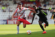 Ronnie Herny and Brighton midfielder, Kazenga LuaLua during the Pre-Season Friendly match between Stevenage and Brighton and Hove Albion at the Lamex Stadium, Stevenage, England on 23 July 2016.