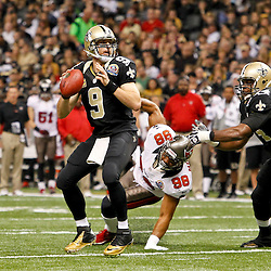 December 16, 2012; New Orleans, LA, USA; New Orleans Saints quarterback Drew Brees (9) throws against the Tampa Bay Buccaneers during the first half of a game at the Mercedes-Benz Superdome. The Saints defeated the Buccaneers 41-0. Mandatory Credit: Derick E. Hingle-USA TODAY Sports