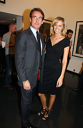 MALIN JOHNANSSON and TIM JEFFERIES at a private view of an exhibition of portrait photographs by Danish photographer Marc Hom held at the Hamiltons Gallery, 13 Carlos Place, London on 23rd October 2006.<br />