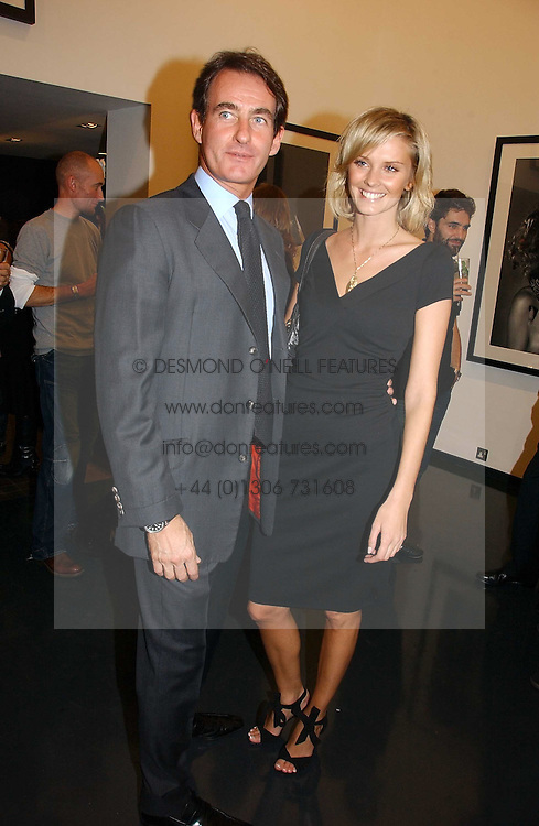 MALIN JOHNANSSON and TIM JEFFERIES at a private view of an exhibition of portrait photographs by Danish photographer Marc Hom held at the Hamiltons Gallery, 13 Carlos Place, London on 23rd October 2006.<br /><br />NON EXCLUSIVE - WORLD RIGHTS