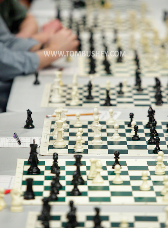 Middletown, NY - Chess pieces on boards during an exhibition at Middletown High School where champion Deepak Aaron played 32 opponents simultaneously on Saturday, Jan. 30, 2010.