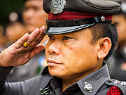 """08 APRIL 2017 - BANGKOK, THAILAND: Thai law enforcement and security personnel at the """"Amazing Songkran"""" festival in Benchasiri Park in Bangkok. The festival was sponsored by the Tourism Authority of Thailand to highlight the cultural aspects of Songkran. Songkran is celebrated in Thailand as the traditional New Year's Day from 13 to 16 April. Songkran is in the hottest time of the year in Thailand, at the end of the dry season and provides an excuse for people to cool off in friendly water fights that take place throughout the country. Songkran has been a national holiday since 1940, when Thailand moved the first day of the year to January 1. Songkran 2017 is expected to be more subdued than Songkran usually is because Thais are still mourning the October 2016 death of revered King Bhumibol Adulyadej.       PHOTO BY JACK KURTZ"""