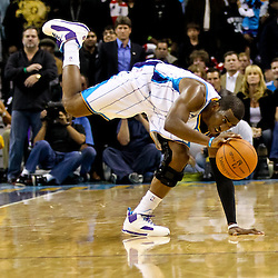 November 5, 2010; New Orleans, LA, USA; New Orleans Hornets point guard Chris Paul (3) tries to regain his balance following a collision during a game against the Miami Heat at the New Orleans Arena. The Hornets defeated the Heat 96-93. Mandatory Credit: Derick E. Hingle