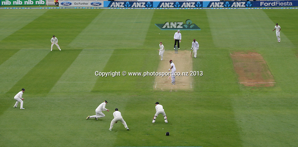 Peter Fulton takes a catch at second slip as Corey Anderson celebrates the wicket of Darren Bravo on Day 2 of the 2nd cricket test match of the ANZ Test Series. New Zealand Black Caps v West Indies at The Basin Reserve in Wellington. Thursday 12 December 2013. Mandatory Photo Credit: Andrew Cornaga www.Photosport.co.nz