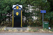 AA phone box for Automobile Association motorists in Brancaster, Norfolk, UK