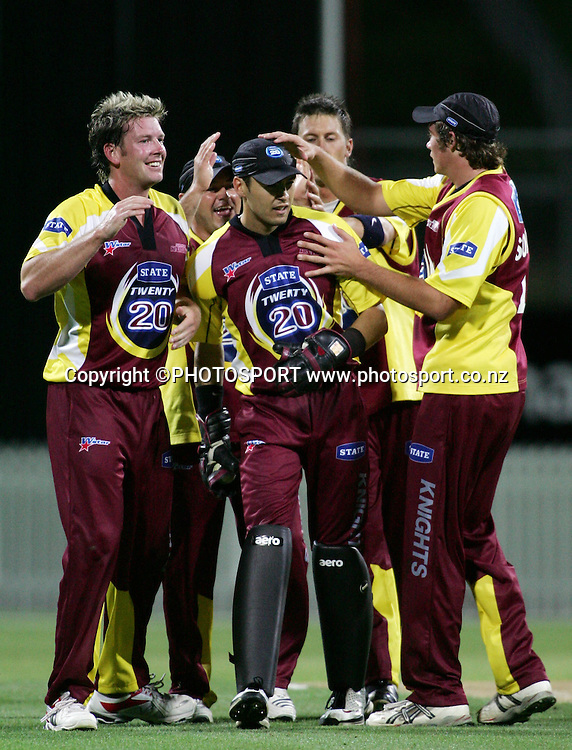 Knights wicket keeper Peter McGlashan is congratulated after running out Robbie Schaw during the State Twenty20 cricket match between the Northern Knights and Central Stags at Seddon Park, Hamilton, on Saturday 13 January 2007. The Knights won the match by 2 runs. Photo: Renee McKay/PHOTOSPORT<br />