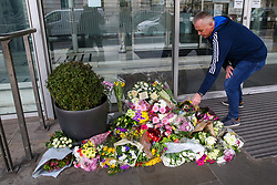 © Licensed to London News Pictures. 16/03/2019. London, UK. A man places flowers at High Commission of New Zealand in London. A gunman killed 49 worshippers at the Al Noor Masjid and Linwood Masjid mosques in Christchurch, New Zealand on 15 March. The 28-year-old Australian suspect, Brenton Tarrant, appeared in court on 16 March and was charged with murder. Photo credit: Dinendra Haria/LNP