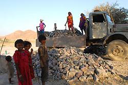 Chitrakoot District, Uttar Pradesh, India: Women stone workers crush stone in the Chitrakoot District of Uttar Pradesh, India.  (Photo by Ami Vitale)