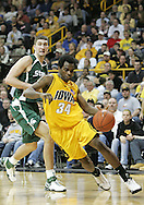 04 JANUARY 2007: Iowa forward Tyler Smith (34) drives by Michigan State center Goran Suton (14) in Iowa's 62-60 win over Michigan State at Carver-Hawkeye Arena in Iowa City, Iowa on January 4, 2007.
