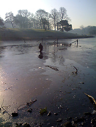 LIVERPOOL, ENGLAND - Tuesday, February 19, 2008: Jon Warren, 52 of Glendale, wades out of the frozen Sefton Park Boating Lake with Louis in his arms after rescuing him from the frozen waters. (Pic by David Rawcliffe/Propaganda)