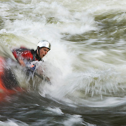 A kayaker plays in a hole in Tariffville Gorge on the Farmington River in Tariffville, Connecticut.  Class III whitewater.