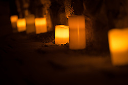 26 October 2017, Prague, Czech Republic: Electric candles light the floor in one of Prague Old Town's old underground locales.