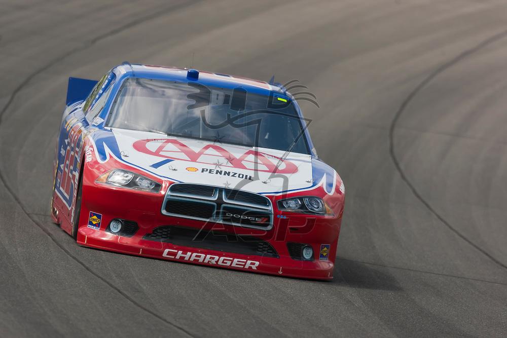KANSAS CITY, KS - APR 20, 2012:  A.J. Almendinger (22) brings his car through the turns during a practice session for the STP 400 at the Kansas Speedway in Kansas City, KS.