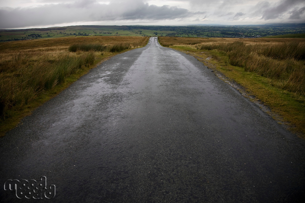 Wet road in Yorkshire Dales Yorkshire England