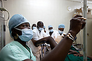 A doctor trains nurses on a surgical procedure at a hospital in Senegal.