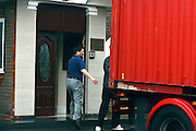 © Licensed to London News Pictures. 09/04/2013. London, UK The container is revised unto the door to prevent media seeing activity. Boxes are loaded into a shipping container from the North Korean Embassy in Ealing London today 9th April 2013. On Friday North Korea warned it would not be able to guarantee the safety of embassy staff in their country in the event of a war. Photo credit : Stephen Simpson/LNP