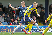 AFC Wimbledon striker Joe Pigott (39) battles for possession with Southend United defender Jason Demetriou (24) during the EFL Sky Bet League 1 match between Southend United and AFC Wimbledon at Roots Hall, Southend, England on 16 March 2019.