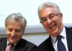 Jean-Claude Trichet, president of the European Central Bank, left, and Guy Quaden, governor of the National Bank of Belgium, share a laugh during an ECB news conference at the National Bank of Belgium, in Brussels, Thurdsday, Dec. 4, 2008. (Photo © Jock Fistick)..