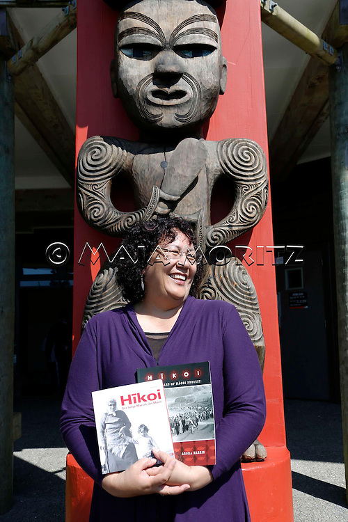 "Aroha Harris, Waitakere Ranges, Auckland, New Zealand, with her book ""Hikoi: 40 Years of Maori Protest"", published in English and German"