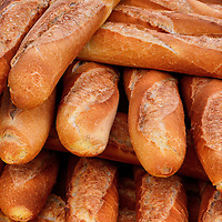 Stack of French Baguettes at Outdoor Market in Fréjus, France