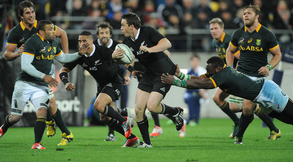 New Zealand's Ben Smith runs from the grip of South Africa's Tendai Mtawarira in the Investec International rugby at Westpac Stadium, Wellington, New Zealand, Saturday, September 13, 2014. Credit:SNPA / Ross Setford