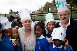 © under license to London News Pictures.  19/05/2011. LONDON, UK. Photocall for The Big Lunch. Barbara Windsor and Chef Antony Worrall Thompson call on Londoners to catch the street party fever. The Big Lunch is an annual one-day get together where neighbours and local communities share lunch and enjoy a street party. Last year, 800,000 people took part across the UK, over 160,000 of which were in London. Photo credit should read Bettina Strenske/LNP