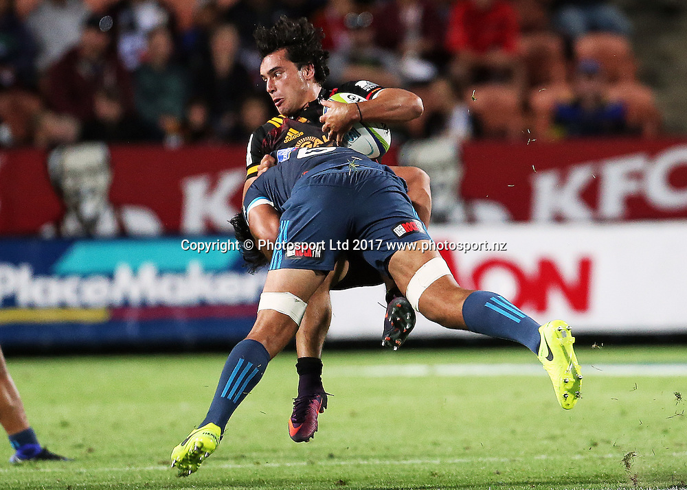 Chiefs' winger James Lowe is hit in a big tackle from Blues' flanker Steven Luatua during the Super Rugby rugby match - Chiefs v Blues played at FMG Stadium Waikato, Hamilton, New Zealand on Friday 3 March 2017.  Copyright photo: Bruce Lim / www.photosport.nz