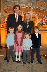 CROWN PRINCE PAVLOS and PRINCESS MARIE CHANTAL OF GREECE with their children, left to right, PRINCE CONSTANTINE, PRINCESS OLYMPIA and PRINCE ACHILEAS and MASTER CONRAD GETTY son of Princess Chantal's sister Pia Getty at a children's party in aid of the charity Over The Wall held at Fortnum & Mason, Piccadilly, London before a gala premiere of the new musical Mary Poppins at The Prince of Wales Theatre, Old Compton Street, London W1<br /><br />NON EXCLUSIVE - WORLD RIGHTS